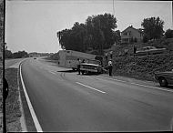 : Truck-Trailer House Wheel Run off Expressway Near Bridge, Sept 1