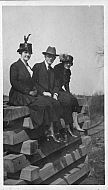 People Sitting on Railroad Ties