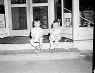 : Mrs. Oscar Bryant - two boys sitting on steps