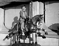 : Marshall Robertson (son on horse)