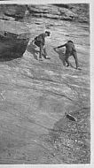 Men Climbing Rock