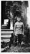 Ray in Uniform in Front of House
