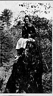 Lady Sitting on a Rock
