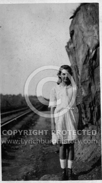 Girl on Railroad Tracks