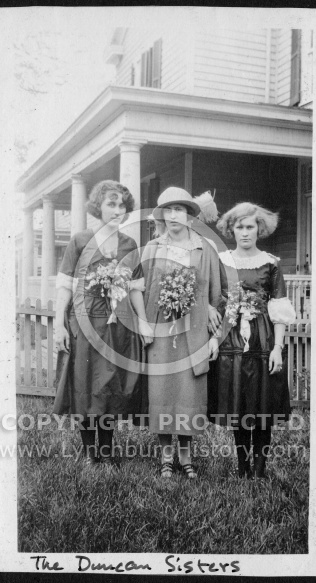 Duncan Sisters Standing in Front of House