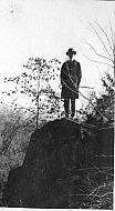 Man on a Rock With Cane