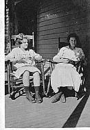 Girl and Woman Sitting on Porch