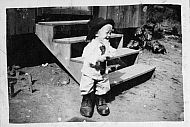 Young Boy in Big Shoes