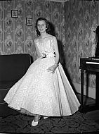 : Shirley Morcom, Evening Gown at Home, april 15, 1955